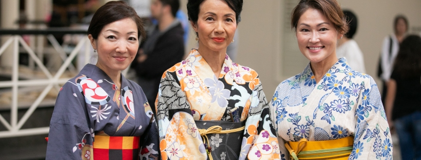 Three women wearing colorful yukata at Greenville Bon Dance Festival
